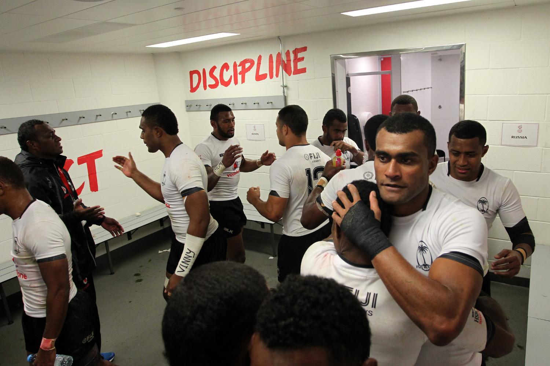 Fiji players hug after winning the HSBC World Rugby Sevens Series