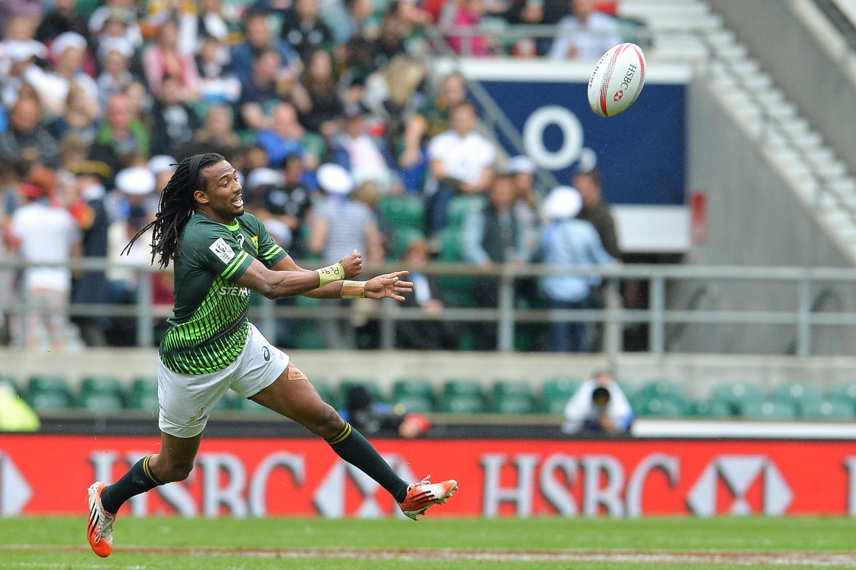 Cecil Afrika flings a pass at the HSBC London Sevens