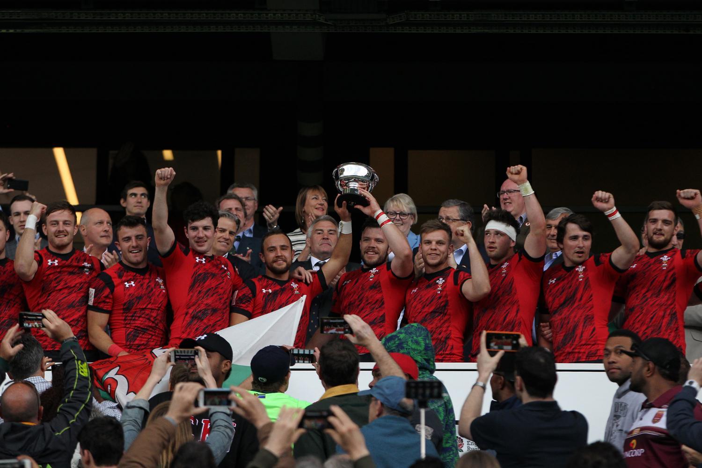 Luke Treharne lifts the Bowl for Wales