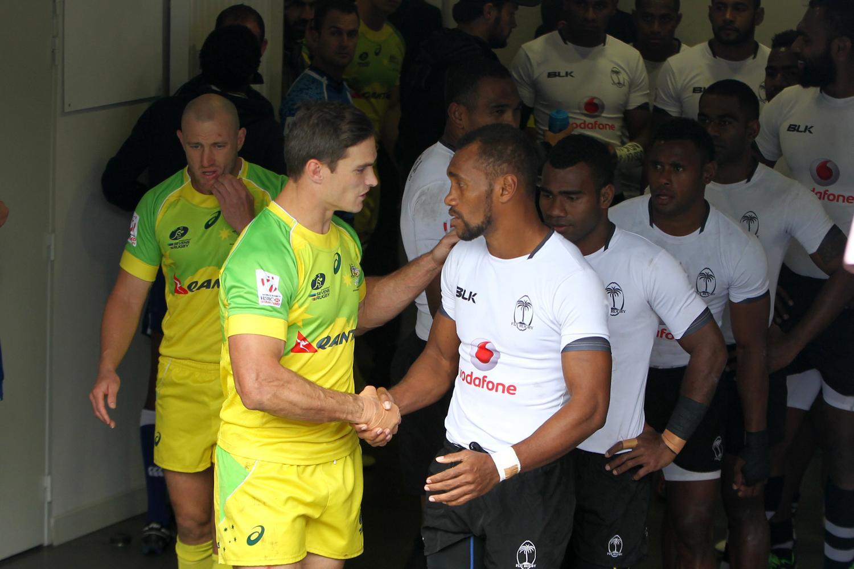 Australia's Ed Jenkins shakes Osea Kolinisau's hand